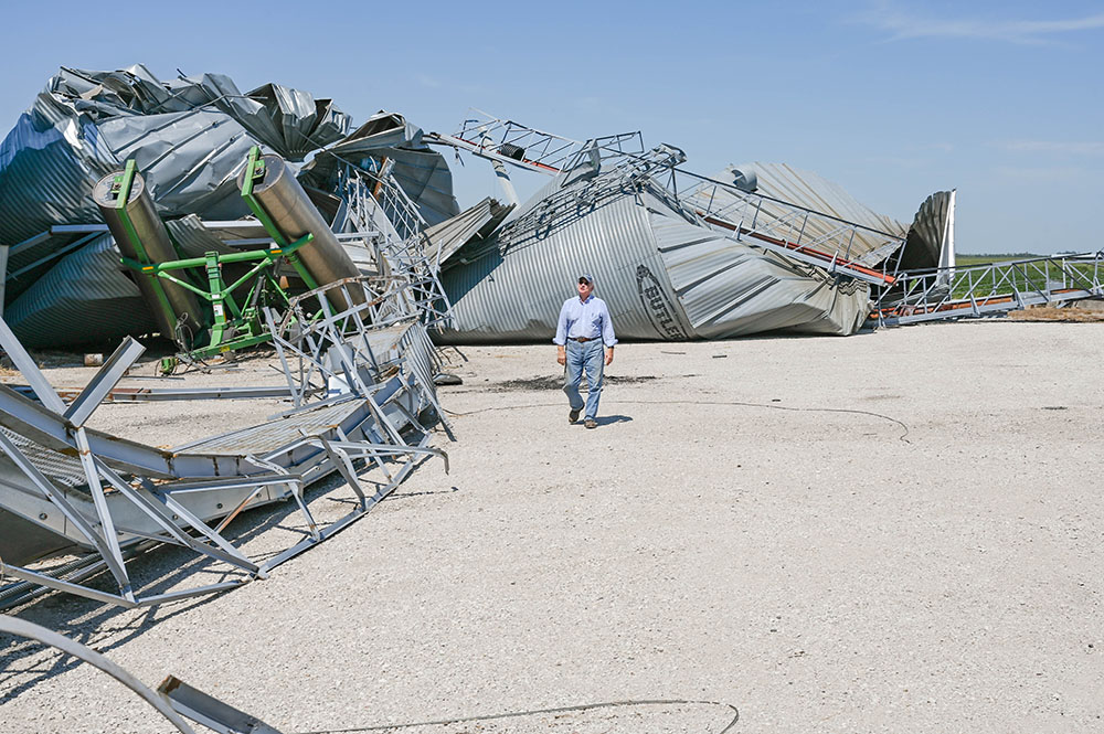 Ron Heck surveys damage caused by the derecho on August