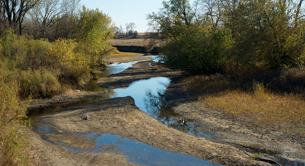 A stream runs dry because of drought conditions.