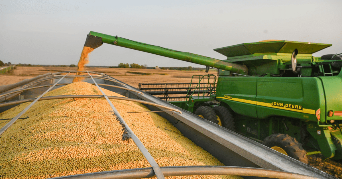 Combine unloads soybeans into semi.