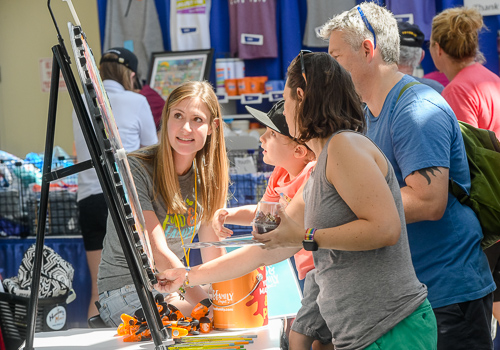 Iowa State Fair-goers engage with the Iowa Food & Family Project volunteers in the Varied Industries Building.
